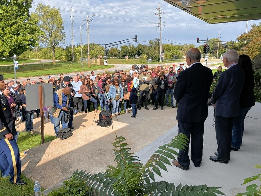A large crowded gathered Sunday in Elgin for a ceremony renaming the Route 20 bridge under Route 31 the Sergeant Marcos Leonardo Gudino Memorial Bridge.