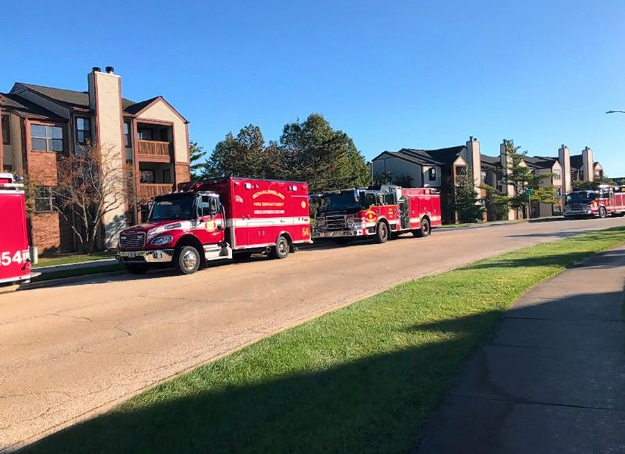 Schaumburg fire vehicles lined the street Sunday outside the Remington Place Apartments as authorities continue to investigate the cause of a fire early Saturday that injured six residents and a firefighter.