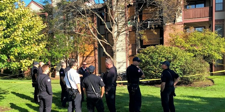 While Schaumburg police and fire investigators continue to seek a cause of a fire early Saturday that injured seven people at the Remington Place Apartments, firefighters were back on the scene Sunday reviewing their response to the blaze.