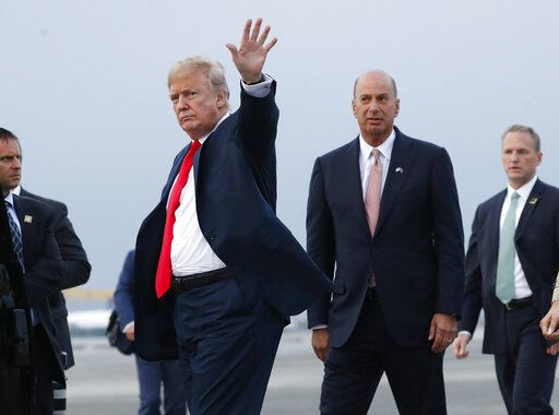FILE - In this Tuesday, July 10, 2018, file photo, President Donald Trump is joined by Gordon Sondland, the U.S. ambassador to the European Union, second from right, as he arrives at Melsbroek Air Base, in Brussels, Belgium. According to text messages released the first week of October 2019 by House investigators, Ambassador Gordon Sondland and Kurt Volker, a former special envoy to Ukraine, discussed Trump wanting to press Ukrainian President Volodymyr Zelenskiy to investigate Trump's Democratic political rival Joe Biden and his family. The House Intelligence Committee is scheduled to meet in private with Sondland.