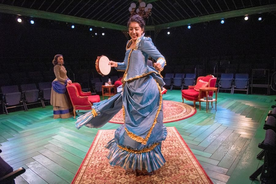 "The pampered Nora (Cher Álvarez), center, practices a dance while her more pragmatic friend Christine (Tiffany Renee Johnson) looks on in Lavina Jadhwani's production of ""A Doll's House"" for Writers Theatre."