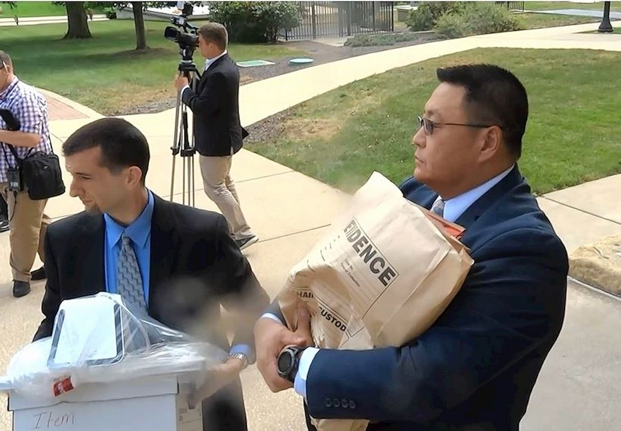 "Unidentified FBI agents carried material out of Chicago Democratic Sen. Martin Sandoval's office at the Illinois Capitol Sept. 24, including a bag marked ""evidence"" and what appeared to be a laptop computer."