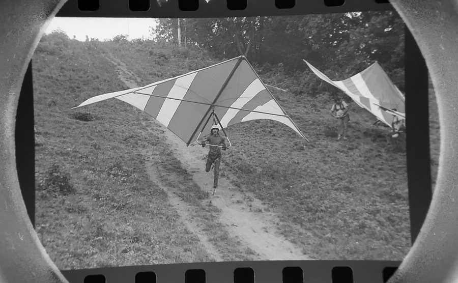 The Daily Herald Archive, Assignment # 33,229, Jim Frost photo: Winging the wind is what skysailing is all about for enthusiasts of the fast-growing sport. A beginner, Calvin Swaback of Elgin, takes a running start from the ski slope at Norge Ski Hill in Fox River Grove in September of 1974.