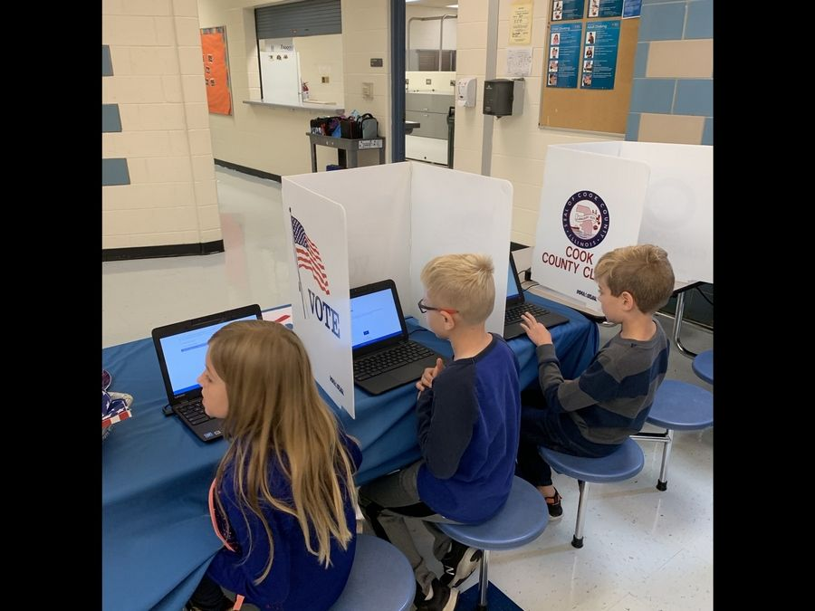 Lions Park students cast their votes in a mock election, using voting booths provided by League of Women Voters.