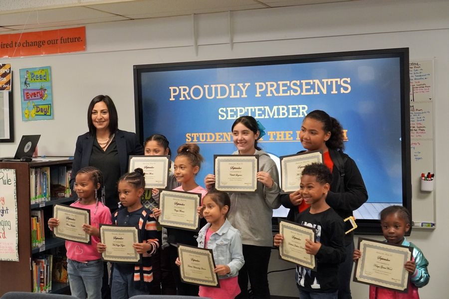 Principal Monica Munoz, left, and her East Elementary Students of the MonthZion Elementary School District 6