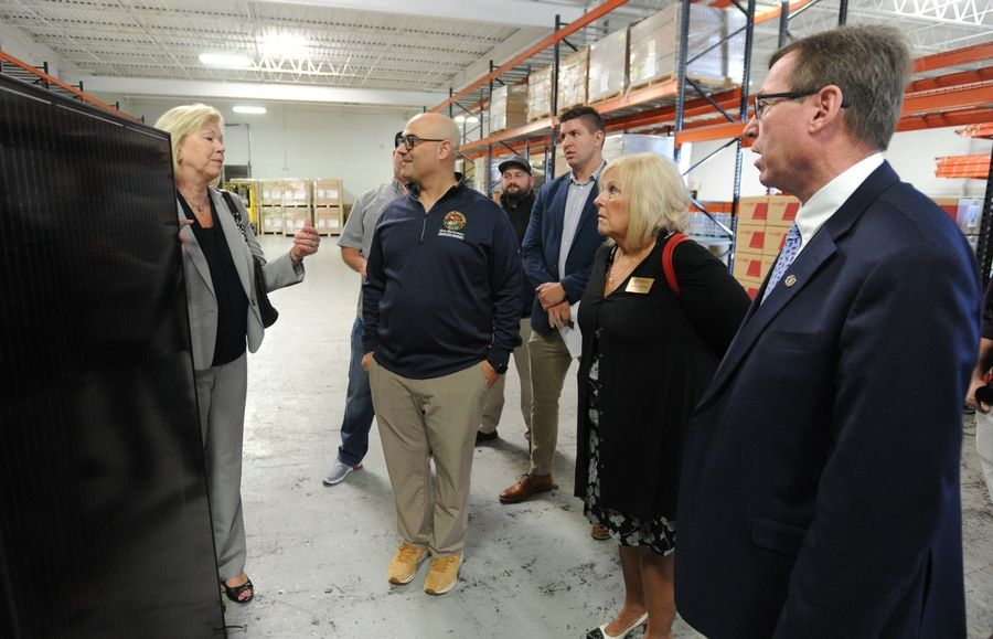 State Sen. Julie Morrison, state Rep. Jonathan Carroll, Wheeling Village Trustee Mary Papantos and Wheeling Economic Development Director John Melaniphy toured the Vivint Solar facility in Wheeling on Monday.
