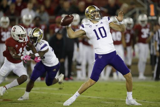 Washington's Jacob Eason passes against Stanford in the second half of an NCAA college football game Saturday, Oct. 5, 2019, in Stanford, Calif.