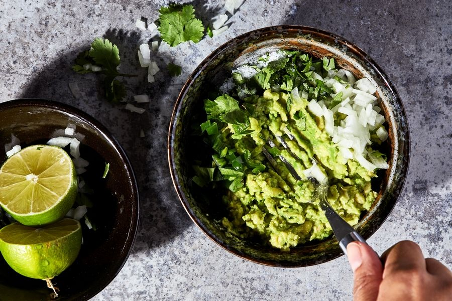 You need nothing more than a bowl and dinner fork to assemble guacamole.