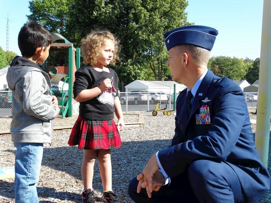 Brig. Gen. Richard Neely, adjutant general of the Illinois National Guard, talks with preschool children during recess Tuesday in Springfield. Neely is promoting a state commitment to early childhood education programs that focus on nutrition, health and physical activity.