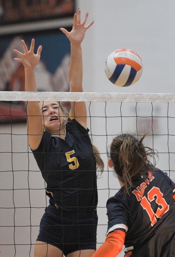 Neuqua Valley's Riley Ammenhauser can't stop a shot by Naperville North's Kara Oxenknecht in a girls volleyball game in Naperville Tuesday.