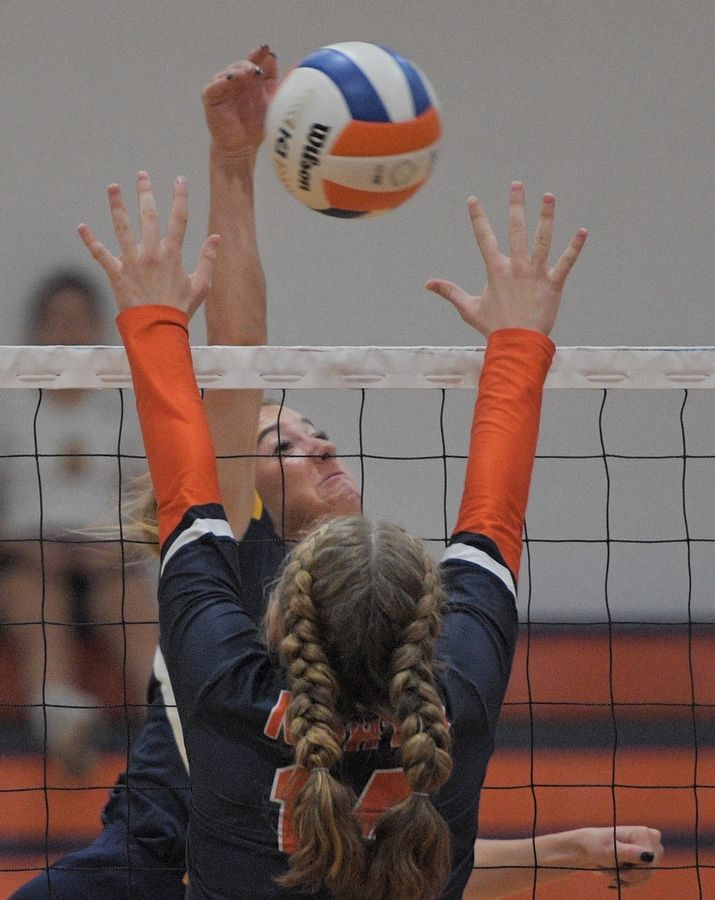 Neuqua Valley's Riley Ammenhauser angles her shot past Naperville North's Paige Lauterwasser in a girls volleyball game in Naperville Tuesday.