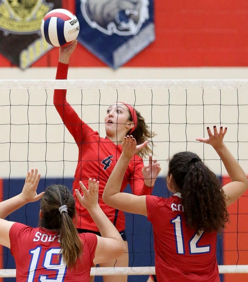 South Elgin's Isabella Tusa hits the ball against Glenbard South in varsity girls volleyball at South Elgin Tuesday night.
