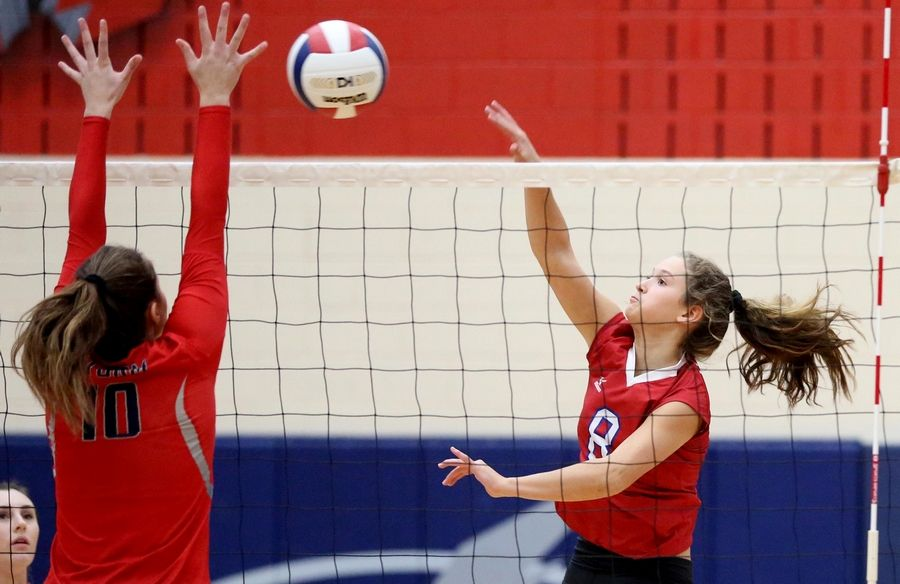 Glenbard South's Brittany Miller hits the ball in varsity girls volleyball at South Elgin Tuesday night.