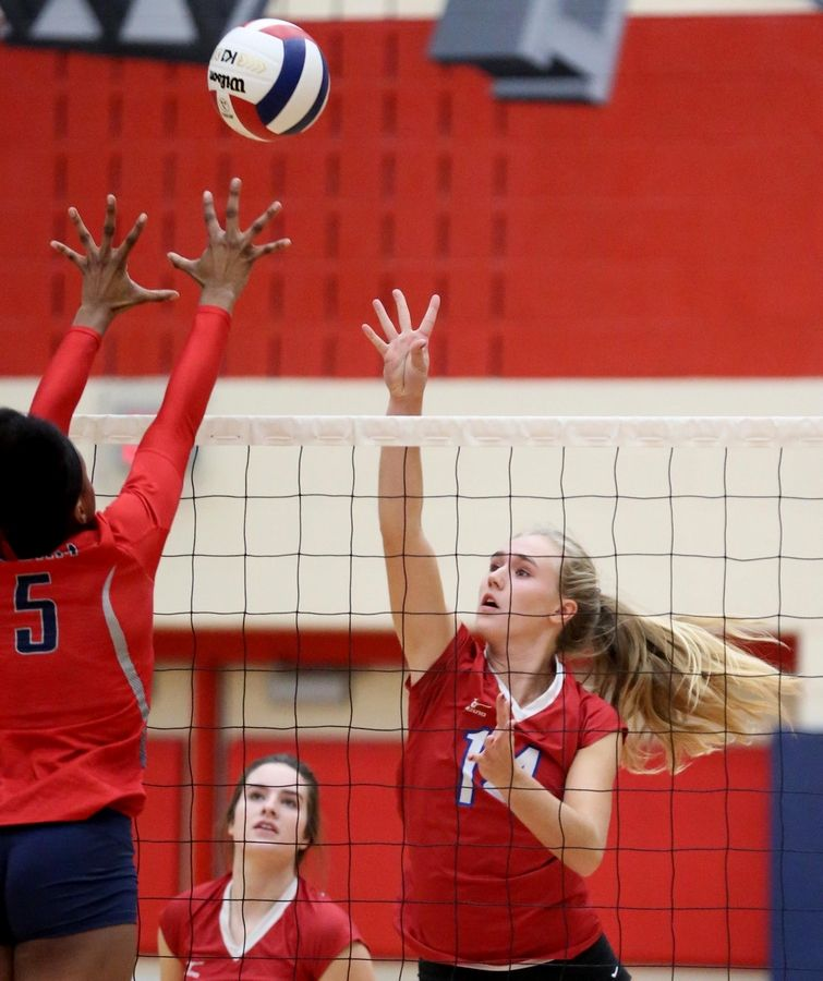 Glenbard South's Alex Wilharm tips the ball in varsity girls volleyball at South Elgin Tuesday night.