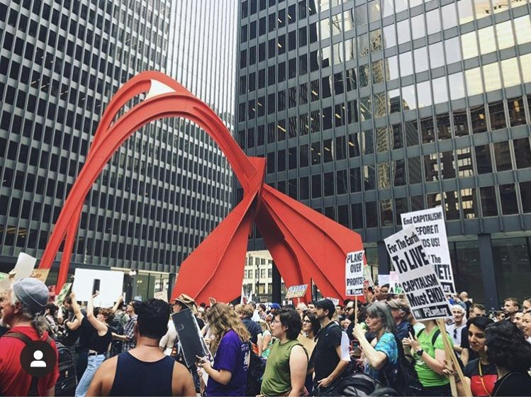 "Crowds gathered by Alexander Calder's ""Flamingo"" for the culmination of the Sept. 20 Climate Strike."