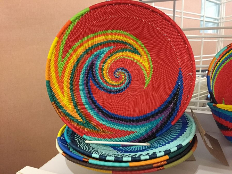 Precision weaving of colorful baskets is just one of the many items available at the Fair Trade Global Market.Ann Wagner