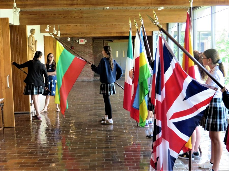 Woodlands Academy students practice their flag-bearing roles in the opening Procession of the Nations, which is part of the annual Flag Ceremony celebrating the Lake Forest day-and-boarding school's rich cultural diversity.