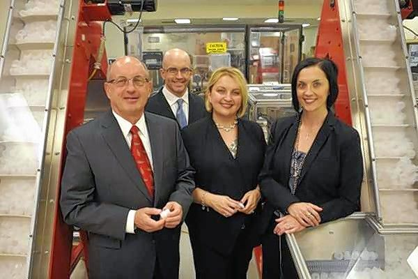 Hoffer Plastics CEO William Hoffer, left, will become chairman of the board as third generation family members Alex Hoffer, second from left, Gretchen Farb and Charlotte Canning take on new leadership roles at the South Elgin manufacturer.