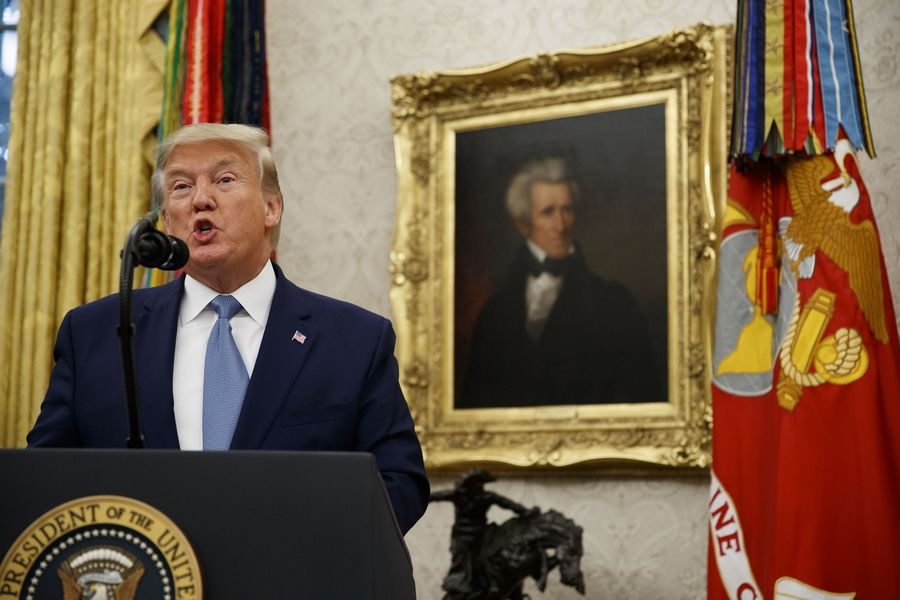 President Donald Trump speaks Tuesday during a ceremony to present the Presidential Medal of Freedom to former Attorney General Edwin Meese in the Oval Office of the White House in Washington.