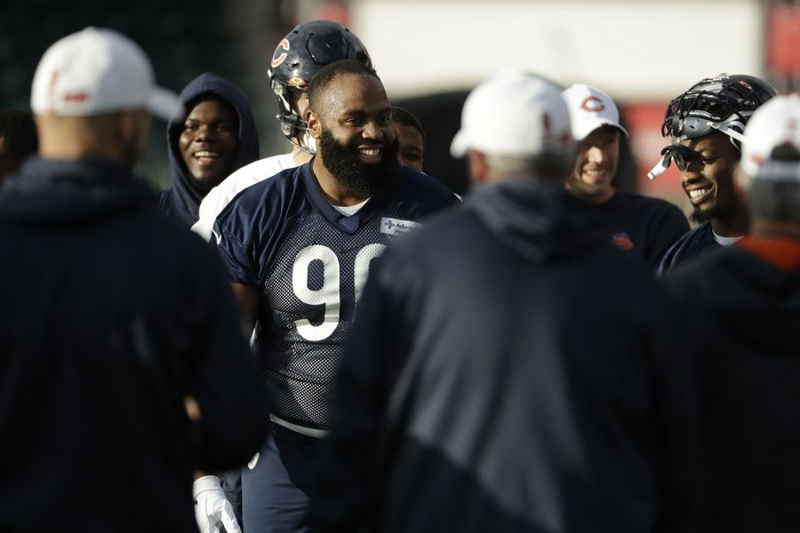 Chicago Bears' defensive end Akiem Hicks, 96, stands in a huddle during an NFL training session at the Allianz Park stadium in London, Friday, Oct. 4, 2019. The Chicago Bears are preparing for an NFL regular season game against the Oakland Raiders in London on Sunday.
