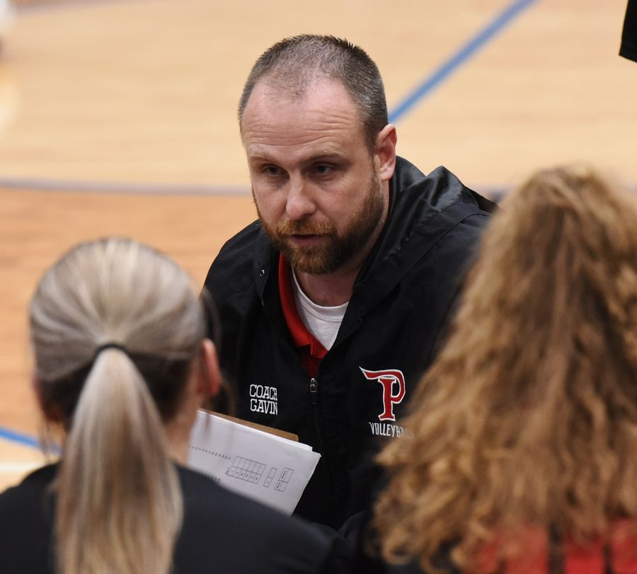 Palatine girls volleyball coach Dan Gavin talks to his team during a timeout at Lake Zurich Wednesday.