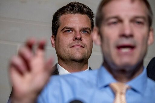 FILE- In this Oct. 8, 2019 photo, Rep. Jim Jordan, R-Ohio, ranking member of the Committee on Oversight Reform, foreground, accompanied by Rep. Matt Gaetz, R-Fla., center, speaks on Capitol Hill in Washington. Gaetz is an unabashed supporter of President Trump, defending him on the impeachment inquiry, the investigation into Russia meddling in U.S. elections and other issues.