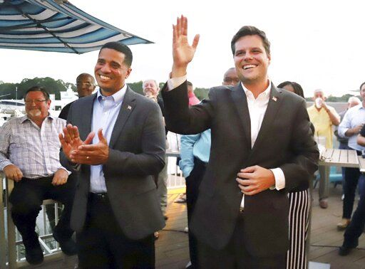 Flanked by U.S. Rep. Matt Gaetz at right, acting Superintendent of Okaloosa County  Schools Marcus Chambers makes his announcement to officially run for the position in the 2020 election during an event in Niceville, Fla., on Tuesday, Oct. 8, 2019. Chambers was appointed to the position in January 2019 by Florida Gov. Ron DeSantis, who removed then-superintendent Mary Beth Jackson.  (Michael Snyder/Northwest Florida Daily News via AP)