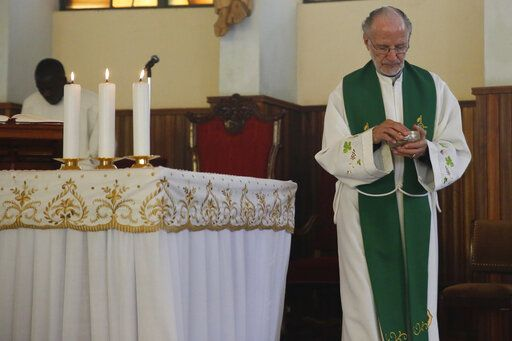 The Rev. Mario Lacchin presides over a Mass at the Restoration Centre Catholic Church in Nairobi, Kenya, on Sunday, June 30, 2019. Sabina Losirkale's family has accused the Italian missionary of impregnating her when she was 16. Lacchin has denied the claim and refused a paternity test.
