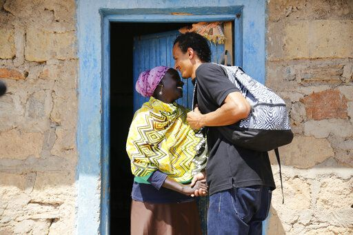 Gerald Erebon is welcomed by his aunt, Scolastica Apayo, at her home in the Isiolo area of the Archers Post settlement in Kenya on Sunday, June 30, 2019. Scolastica said her sister, Sabina Losirkale, finally told her the secret in 2012, two weeks before she died. 'œNow that my days are over,'� her sister told her, she could reveal all: 'œWhen Gerald will ask you who's his father, just tell him: Father Mario.'�
