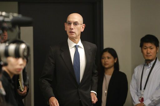 NBA Commissioner Adam Silver arrives for a news conference before an NBA preseason basketball game between the Houston Rockets and the Toronto Raptors Tuesday, Oct. 8, 2019, in Saitama, near Tokyo.