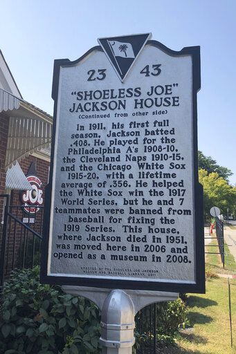 In this Sept. 29, 2019, photo, a sign outside the Shoeless Joe Jackson Museum is shown in Greenville, S.C.