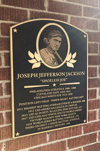 In this Sept. 29, 2019, photo, a plaque outside the Shoeless Joe Jackson Museum is shown in Greenville, S.C.