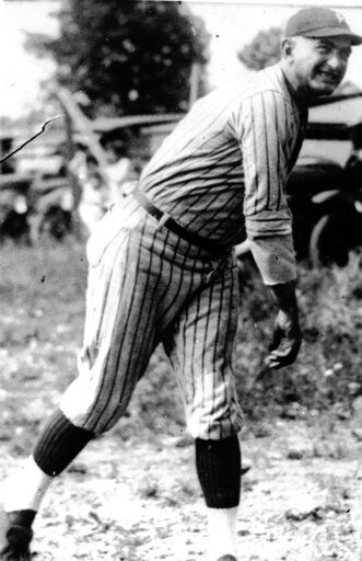 FILE - This undated file photo shows Shoeless Joe Jackson.  On the 100th anniversary of the Chicago White Sox finishing off their infamous throwing of the 1919 World Series to the Cincinnati Reds, stamping themselves for eternity as the Black Sox, Shoeless Joe stirs up harsh feelings and fierce debate about his place, or, more accurately, non-place, within the game.