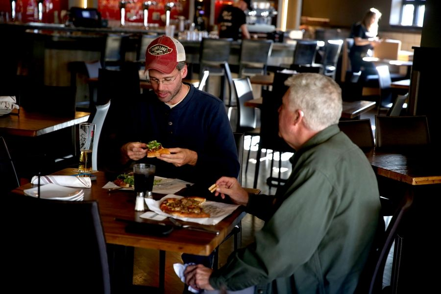 Eric Selin and his dad, Eric Sr., of Elgin, dine at Woodfire Brick Oven Pizza.