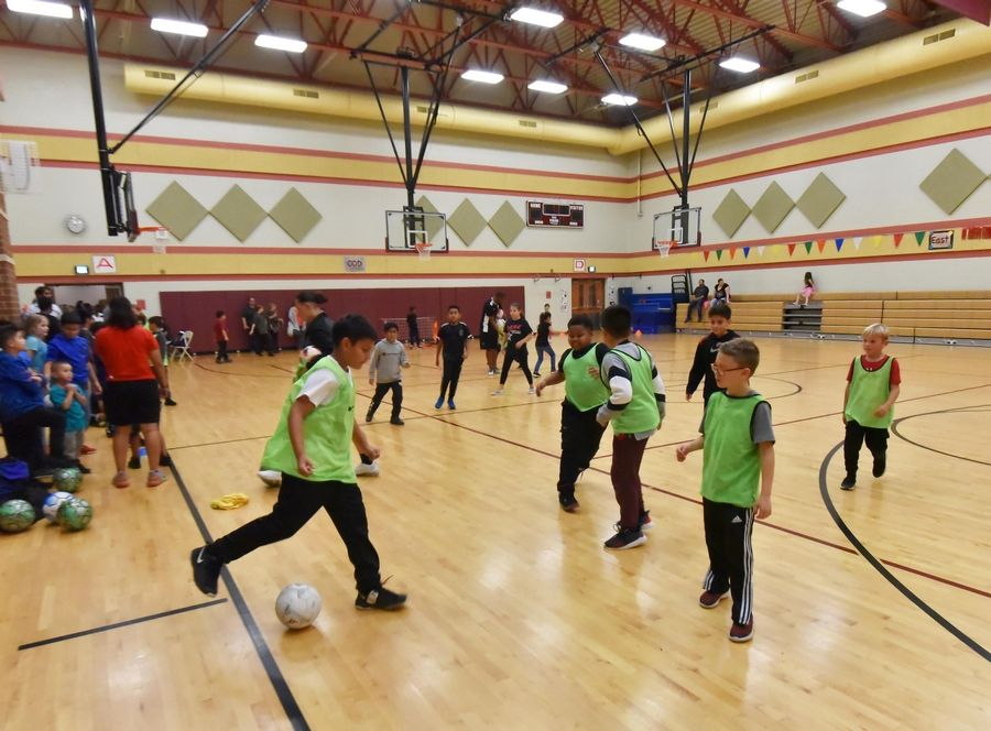 Boys play soccer in the gymnasium Thursday during the Gurnee School District 56 Hispanic Heritage Celebration at Prairie Trail School in Wadsworth.