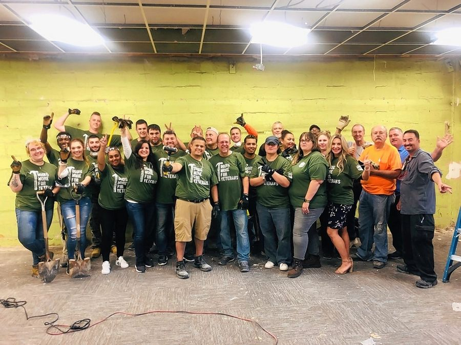 Participants in the The Des Plaines Chamber of Commerce & Industry's Back to Work Boot Camp and volunteers from Rivers Casino and The Home Depot assemble before beginning renovation work at the American Legion Hall, 1291 Oakwood Ave., in Des Plaines.