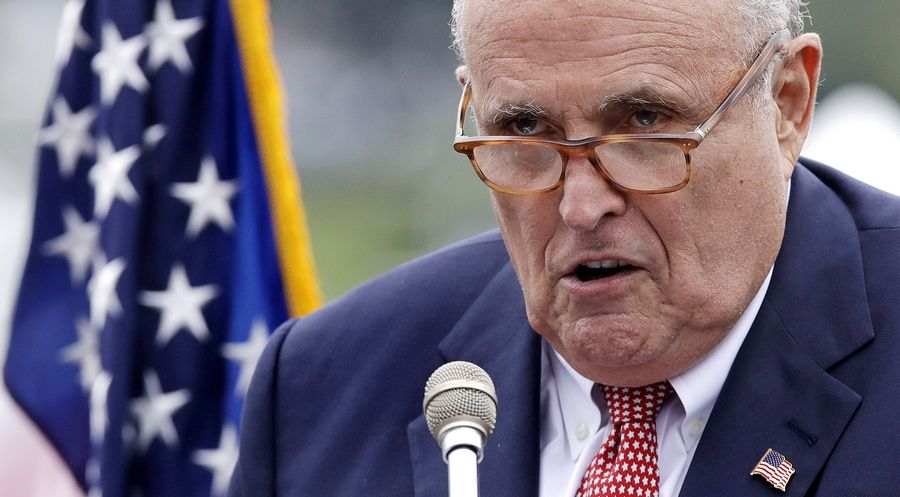 FILE -- This Aug. 1, 2018, file photo shows Rudy Giuliani, an attorney for President Donald Trump, in Portsmouth, N.H. As Giuliani was pushing Ukrainian officials in the spring of 2019 to investigate one of Donald Trump's main political rivals, a group of individuals with ties to the president and his personal lawyer were also active in the former Soviet Republic.