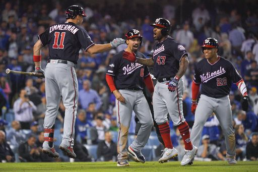 Washington Nationals' Howie Kendrick (47) celebrates after a grand slam against the Los Angeles Dodgers during the 10th inning in Game 5 of a baseball National League Division Series on Wednesday, Oct. 9, 2019, in Los Angeles.
