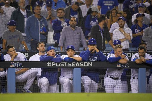Members of the Los Angeles Dodgers react to the team's 7-3 loss to the Washington Nationals in Game 5 of a baseball National League Division Series on Wednesday, Oct. 9, 2019, in Los Angeles.