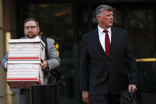 Kevin Downing, right, an attorney representing Lev Parnas and Igor Fruman, leaves the federal courthouse in Alexandria, Va., Thursday, Oct. 10, 2019.