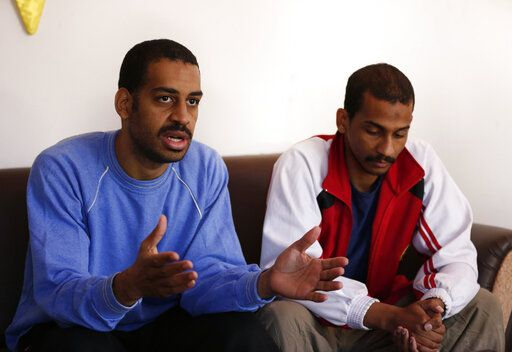 "FILE - In this March 30, 2019, file photo, Alexanda Amon Kotey, left, and El Shafee Elsheikh, who were allegedly among four British jihadis who made up a brutal Islamic State cell dubbed ""The Beatles,"" speak during an interview with The Associated Press at a security center in Kobani, Syria, Friday, March 30, 2018. The men said that their home country's revoking of their citizenship denies them a fair trial. ""The Beatles"" terror cell is believed to have captured, tortured and killed hostages including American, British and Japanese journalists and aid workers."