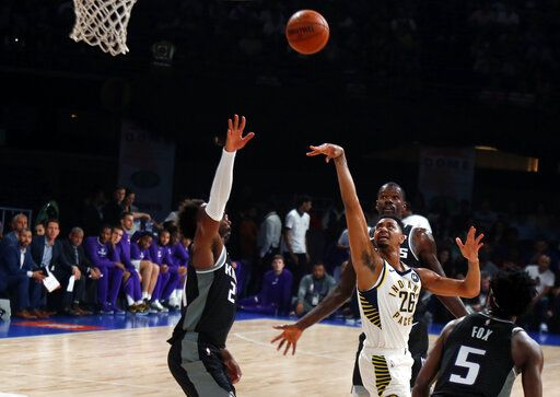 Indiana Pacers player Jeremy Lamb, white, plays against Sacramento Kings at the NBA India Games 2019, in Mumbai, India, Saturday, Oct. 5, 2019.