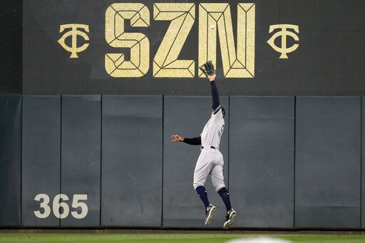 New York Yankees right fielder Aaron Judge catches a fly ball hit by Minnesota Twins' Miguel Sano during the sixth inning in Game 3 of a baseball American League Division Series, Monday, Oct. 7, 2019, in Minneapolis.