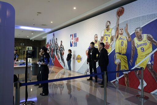 Security personnel wait for spectators to arrive at a checkpoint to an NBA preseason game to be held at the Mercedes Benz Arena in Shanghai, China, Thursday, Oct. 10, 2019. All media events such as news conferences have been canceled inside the arena hosting Thursday's NBA preseason game in China between the Los Angeles Lakers and Brooklyn Nets, though the matchup itself remains on as scheduled.