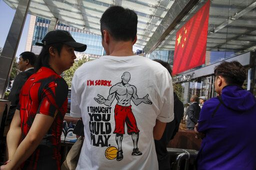 Chinese fans wearing dedicated t-shirt as they waiting for NBA players outside the Ritz-Carlton hotel in Shanghai, China, Thursday, Oct. 10, 2019. NBA Commissioner Adam Silver told the Brooklyn Nets and Los Angeles Lakers on Wednesday that the league is still expecting them to play as scheduled this week, even while the rift between the league and Chinese officials continued in ways that clearly suggested the two planned games in Shanghai and Shenzhen were anything but guaranteed.