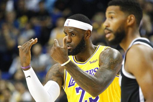 Los Angeles Lakers' Lebron James gestures during a preseason NBA game against the Brooklyn Nets in Shanghai, China, Thursday, Oct. 10, 2019. All of the usual media sessions surrounding the Lakers-Nets preseason game in Shanghai on Thursday - including a scheduled news conference from NBA Commissioner Adam Silver and postgame news conferences with the teams - were canceled. It was the latest salvo in the rift between the league and China stemming from a since-deleted tweet posted last week by Morey, the general manager of the Houston Rockets.