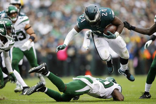 Philadelphia Eagles' Jordan Howard, right, is tackled by New York Jets' Marcus Maye during the second half of an NFL football game, Sunday, Oct. 6, 2019, in Philadelphia.