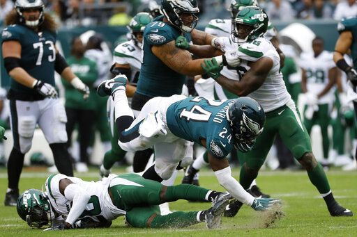 Philadelphia Eagles' Jordan Howard (24) is tackled by New York Jets' Marcus Maye (20) during the second half of an NFL football game, Sunday, Oct. 6, 2019, in Philadelphia.