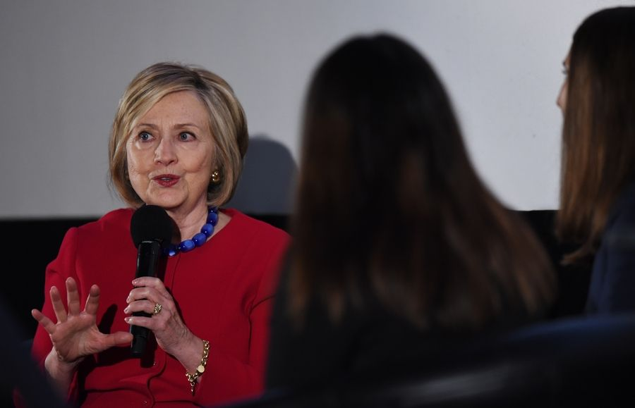 Former U.S. Secretary of State Hillary Clinton answers questions posed by high school journalists Friday during a tribute to Trailblazing Women of Park Ridge at the Pickwick Theater.