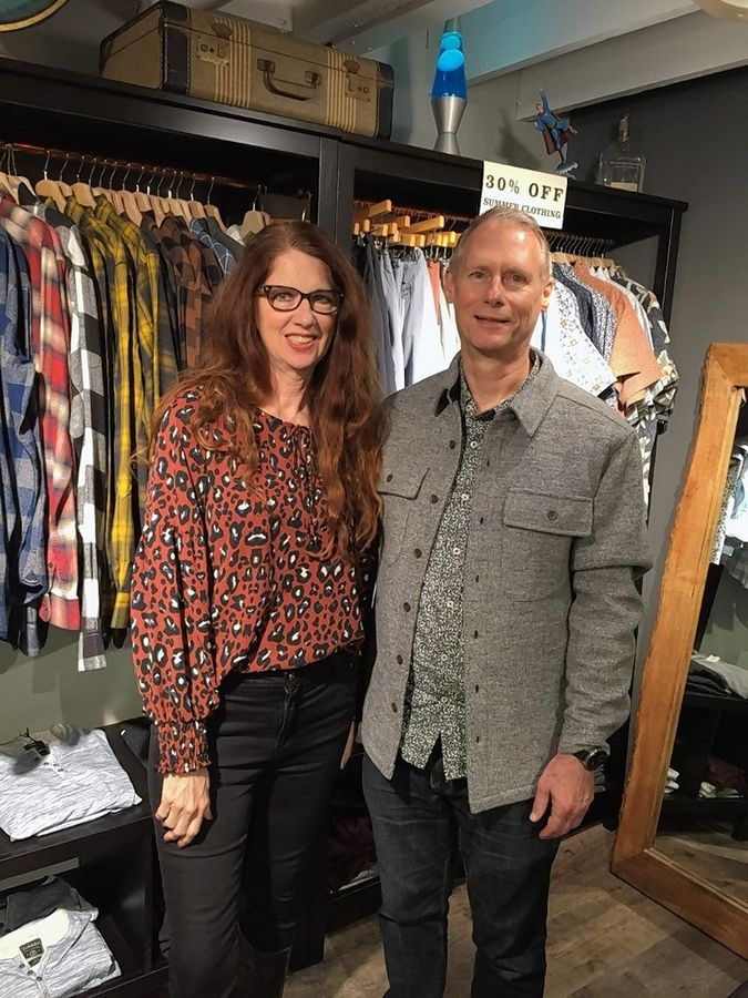 Kathryn and Steve Quinn are owners of Flourish women's boutique and Motto men's clothing store along Third Street in Geneva.